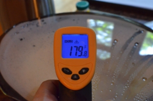 Infrared thermometer lets you check temp through the plastic wrap.  Almost to 180.